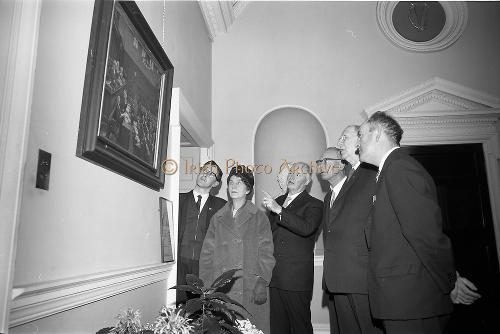 26/03/1966<br /> 03/26/1966<br /> 26 March 1966<br /> President receives Banna Strand Memorial Committee at Aras an Uachtarain. Officials of the combined committees of the Roger Casement Association, the Banna Strand Memorial Committee and the Limerick Roger Casement Association, met in Dublin and discussed with President Eamon de Valera about arrangements for the Roger Casement Commemoration Ceremonies to be held at Banna Strand, Co. Kerry, on Good Friday.<br /> Picture shows the President showing the Committee the painting by Sir John Lavery, R.A., R.H.A., of the &quot;Trial of Roger Casement in London 1916&quot;, hanging in the reception hall at Aras an Uachtarain. Included are (l-r): Sean S. O Conchubhair, Secretary/Treasurer, National Executive, Banna Strand Memorial Committee; Mrs Mary McInerney-Spillane, P.C., Assistant Treasurer, Limerick Roger Casement Association; Dr Herbert Mackey, Dun Laoghaire, President, Dublin Roger Casement Association; Mr Tadhg Smalle, P.C., Chairman, Limerick Roger Casement Association and Mr Eamonn O Mathuna, Chairman, National Executive, Banna Strand memorial Committee.