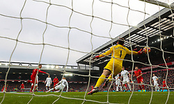Liverpool's Roberto Firmino scores his side's first goal of the game during the Premier League match at Anfield, Liverpool.