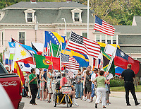 The parade of flags lines up for the annual Multicultural Day festivities.  (Karen Bobotas/ for the Laconia Daily Sun)