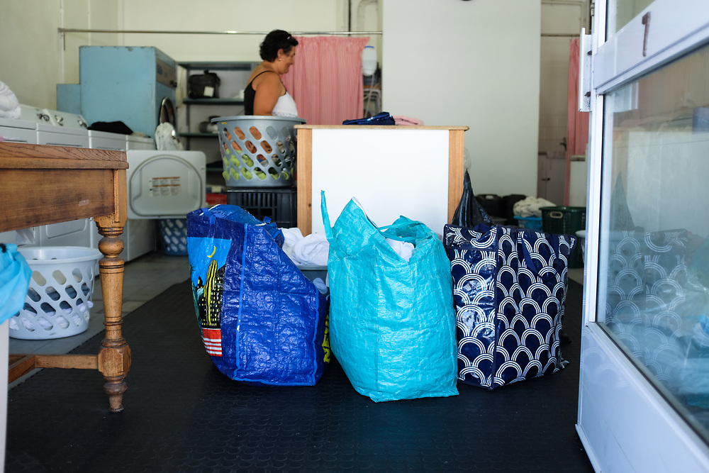 Laundromats have seen increased business in Cape Town as people try to offset their municipal water limit of 50L a day.