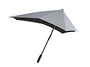 Brolly that can beat 70mph winds: New cycle helmet style design is unflappable on stormiest of days<br /> <br /> It is one of life's little frustrations: you brace yourself with an umbrella on a stormy day, but the moment you step outside it blows inside out.<br /> Now blustery conditions could become a breeze with the help of a storm-proof umbrella.<br /> Tapered at the back, rather like a cyclist's racing helmet, it is said to be able to withstand winds of up to 70mph. <br /> The asymmetrical design is also easier to hold upright, helping its carriers appear unflappable on the stormiest of days.<br /> Tests in a wind tunnel found that some women were unable to hold a normal umbrella in gale-force winds, but they did not struggle with the Senz design. <br /> Meanwhile, the arm muscles of both men and women in the wind tunnel did a third less work when carrying the storm-proof brolly, according to a Dutch study published in the journal Applied Ergonomics.<br /> <br /> The Senz umbrella, which is thought to be the only type of its kind, was dreamt up by a Dutch industrial engineering student, Gerwin Hoogendoorn, after storms broke three of his brollies in a week.<br /> After running up the prototype on his grandmother's sewing machine, he formed a company with two university friends and now sells the umbrellas globally, with prices starting at £20.<br /> The secret to their success is said to lie in the aerodynamic design which directs wind over and around the umbrellas, holding them in position.<br /> ©Senz umbrella/Exclusivepix