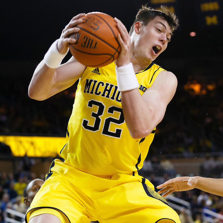 Feb 22, 2015; Ann Arbor, MI, USA; Michigan Wolverines forward Ricky Doyle (32) goes to the basket in the first half against the Ohio State Buckeyes at Crisler Center. Mandatory Credit: Rick Osentoski-USA TODAY Sports