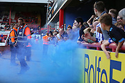 Sheffield Wednesday fans after the goal set off a flare during the Sky Bet Championship match between Brentford and Sheffield Wednesday at Griffin Park, London, England on 26 September 2015. Photo by Phil Duncan.