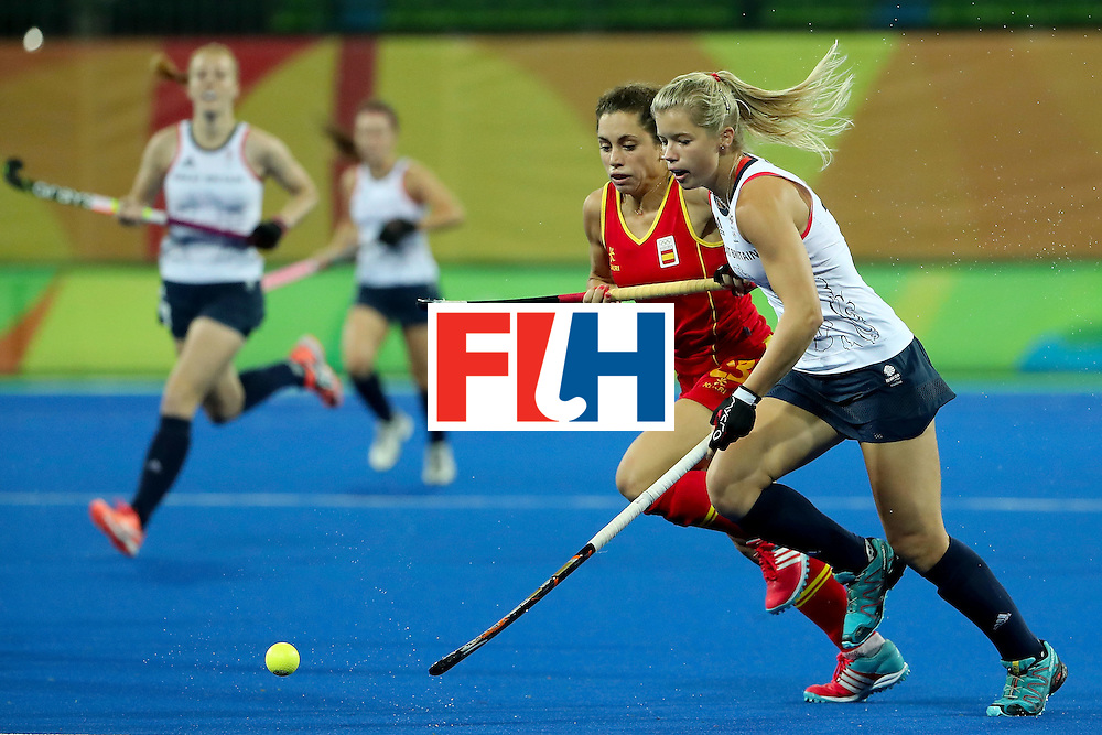 RIO DE JANEIRO, BRAZIL - AUGUST 15:  Sophie Bray #19 of Great Britain moves the ball past Georgina Oliva #23 of Spain during the first half of the quarter final hockey game on Day 10 of the Rio 2016 Olympic Games at the Olympic Hockey Centre on August 15, 2016 in Rio de Janeiro, Brazil.  (Photo by Christian Petersen/Getty Images)