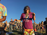 06212016 - Noblesville, Indiana, USA: A neo-Prankster named Wizard of Wonder dances on the lawn at Klipsch Music Center (Deer Creek) as members of the Grateful Dead perform as Dead and Company. The Grateful Dead's final show at  Deer Creek in July 1995 was marred by over a thousand fans crashing the gates leading to the next day's show being canceled. Grateful Dead guitarist Jerry Garcia died a few weeks later. (Jeremy Hogan/Polaris)