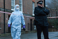 © Licensed to London News Pictures. 30/12/2012. London, UK. A Metropolitan Police Officer and a member of the forensic team at the crime scene of a stabbing in Wapping Woods, East London where a woman was attacked on 29 December 2012. This is the second stabbing in Wapping Woods this month. Photo credit : Vickie Flores/LNP