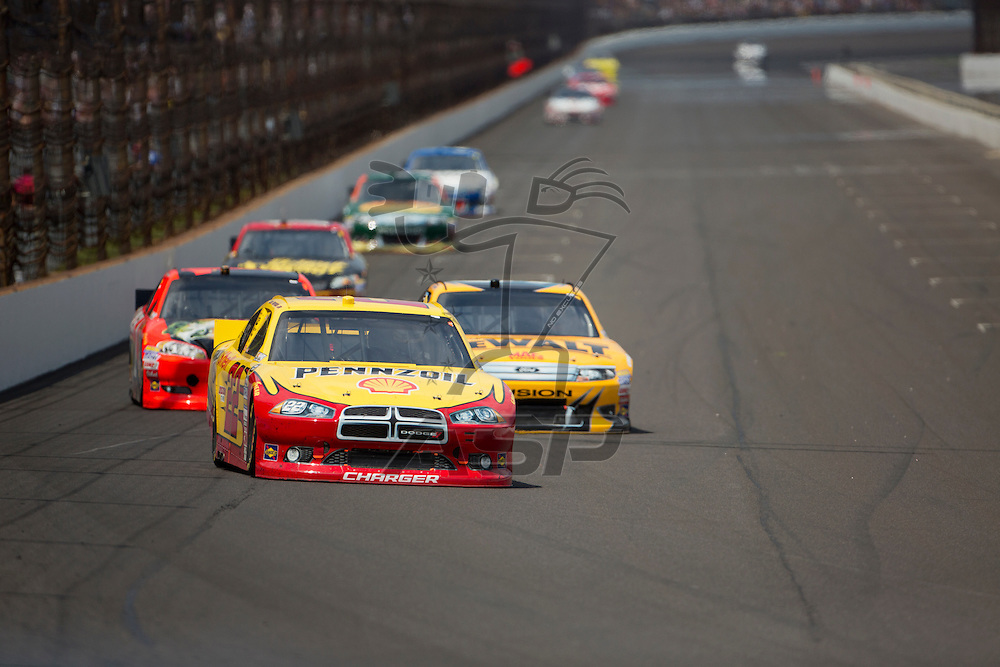 INDIANPOLIS, IN - JUL 29, 2012:  A.J. Almendinger (22) brings his car down the front stretch during the Curtiss Shaver 400 presented by Crown Royal Sprint Cup Series race at the Indianapolis Motor Speedway in Indianapolis, IN.