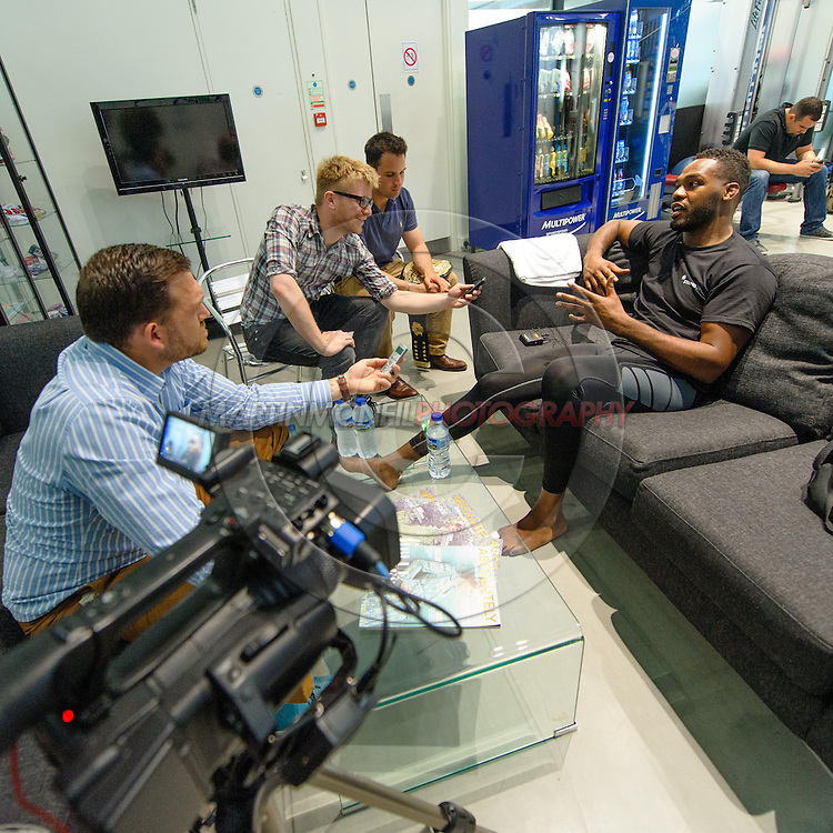 LONDON, ENGLAND, AUGUST 2, 2013: UFC light-heavyweight champion Jon Jones relaxes whilst being interviewed inside Stars Gym in Battersea, London on Friday, August 2, 2013 © Martin McNeil