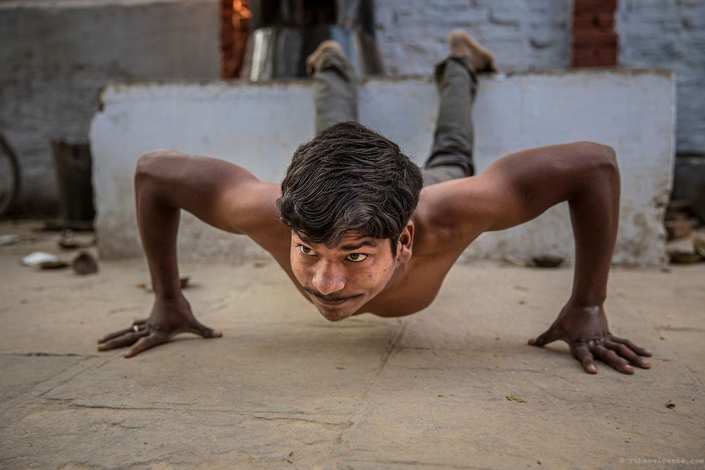 Kushti wrestler doing push ups. Varanasi, India