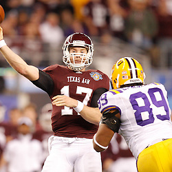 Jan 7, 2011; Arlington, TX, USA; LSU Tigers defensive end Lavar Edwards (89) pressures Texas A&M Aggies quarterback Ryan Tannehill (17) during the third quarter of the 2011 Cotton Bowl at Cowboys Stadium.  Mandatory Credit: Derick E. Hingle