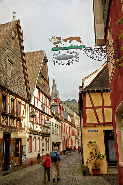View of a Bacharach street showing pubs, restaurants, and tourists, Bacharach, Germany.