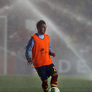 Santi Cazorla, Spain, laughs as the sprinklers are turned on at half time as he warms up during the Spain V Ireland International Friendly football match at Yankee Stadium, The Bronx, New York. USA. 11th June 2013. Photo Tim Clayton