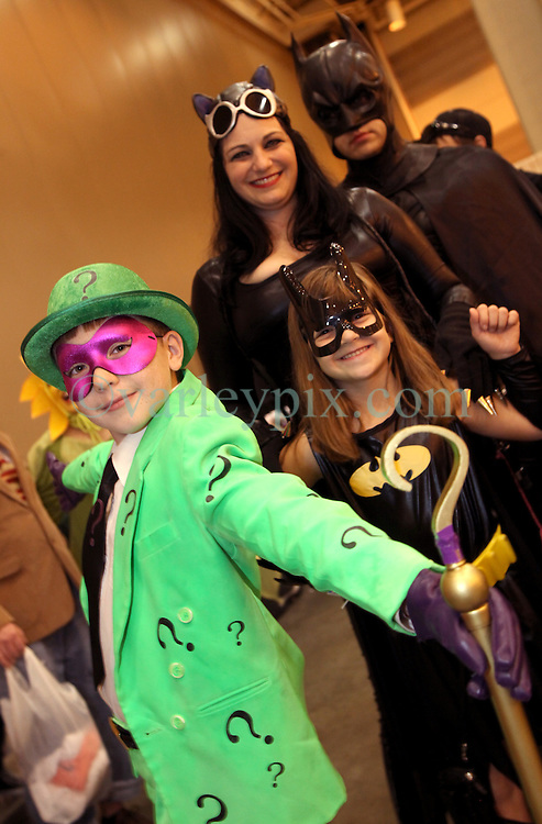 29 Jan 2012. New Orleans, Louisiana USA. <br /> The Dunn family, Xavier (10 yrs), Jade (6 yrs) Vanessa and Blaise dress as Batman characters at the Wizard World New Orleans Comic Con at the Ernest N Morial Convention Center. <br /> Photo; Charlie Varley/varleypix.com