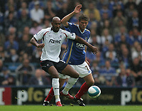 Photo: Lee Earle.<br /> Portsmouth v Bolton Wanderers. The FA Barclays Premiership. 18/08/2007.Bolton's Nicolas Anelka (L) battles with Hermann Hreidarsson.