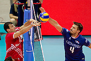 (R) Antonin Rouzier from France attacks against (L) Halil Ibrahim Yucel from Turkey during the 2013 CEV VELUX Volleyball European Championship match between France and Turkey at Ergo Arena in Gdansk on September 22, 2013.<br /> <br /> Poland, Gdansk, September 22, 2013<br /> <br /> Picture also available in RAW (NEF) or TIFF format on special request.<br /> <br /> For editorial use only. Any commercial or promotional use requires permission.<br /> <br /> Mandatory credit:<br /> Photo by © Adam Nurkiewicz / Mediasport