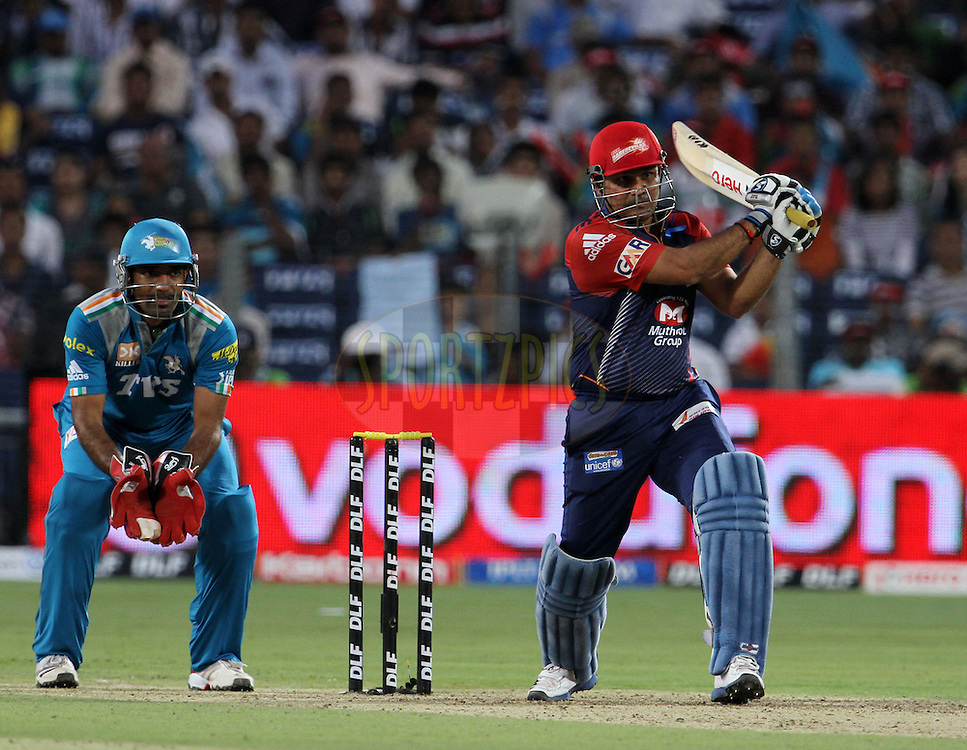 Delhi Daredevils captain Virender Sehwag plays a shot during match 31 of the Indian Premier League ( IPL) 2012  between The Pune Warriors India and the Delhi Daredevils held at the Subrata Roy Sahara Stadium, Pune on the 24th April 2012..Photo by Vipin Pawar/IPL/SPORTZPICS