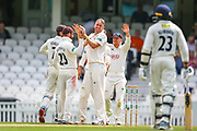 Wicket! Rikki Clarke of Surrey celebrates taking the wicket of Sean Dickson of Kent during the Specsavers County Champ Div 1 match between Surrey County Cricket Club and Kent County Cricket Club at the Kia Oval, Kennington, United Kingdom on 10 July 2019.