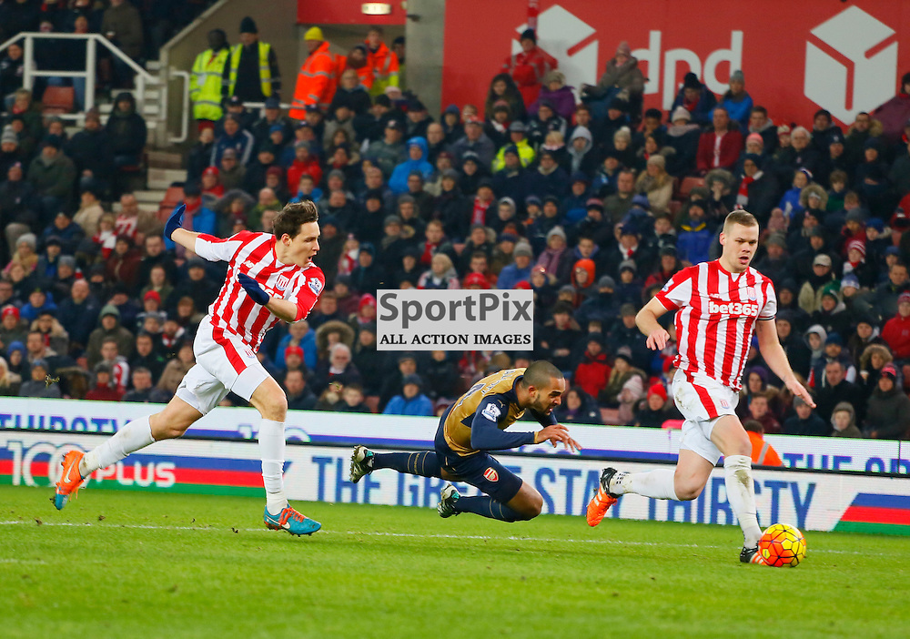 Philipp Wollscheid comes together with Theo Walcott as Arsenal want a pentaly during Stoke City v Arsenal, Barclays Premier League, Sunday 17th January 2016, Britannia Stadium, Stoke