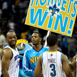 March 30, 2011; New Orleans, LA, USA; New Orleans Hornets power forward Carl Landry (24) small forward Patrick Ewing Jr. (22) and point guard Chris Paul (3) celebrate following a win over the Portland Trail Blazers at the New Orleans Arena. The Hornets defeated the Trail Blazers 95-91.   Mandatory Credit: Derick E. Hingle