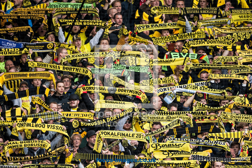 The Yellow Wall of Borussia Dortmund fans during the Bundesliga match at Signal Iduna Park, Dortmund<br /> Picture by EXPA Pictures/Focus Images Ltd 07814482222<br /> 14/05/2016<br /> ***UK &amp; IRELAND ONLY***<br /> EXPA-EIB-160515-0067.jpg