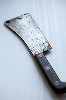 Antique and rusty meat cleaver.