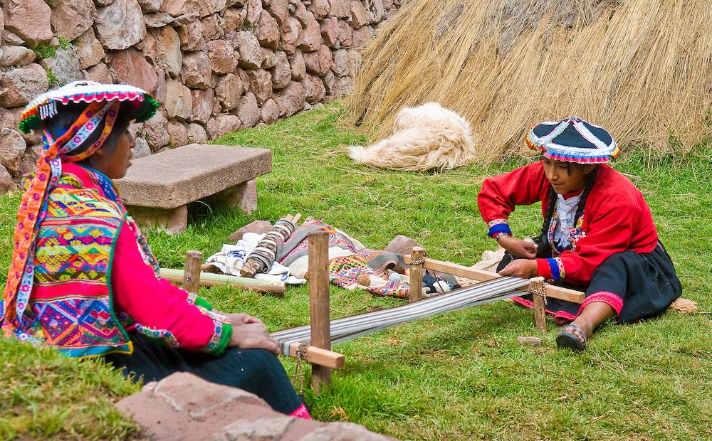 Cusco , Peru - May 26 2011 : Quechua Indian women weaving with strap loom