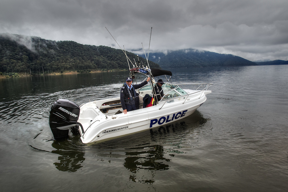 Mitta Mitta, one policeman town. Following the working life of Leading Senior Constable John Kissane. On Lake Dartmouth with Water Police Leading Senior Constable Brett Tanian, checking boat &amp; gun licenses. Pic By Craig Sillitoe CSZ/The Sunday Age.27/03/2012 This photograph can be used for non commercial uses with attribution. Credit: Craig Sillitoe Photography / http://www.csillitoe.com<br />