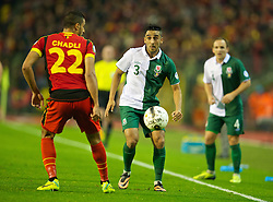 BRUSSELS, BELGIUM - Tuesday, October 15, 2013: Wales' Neil Taylor in action against Belgium during the 2014 FIFA World Cup Brazil Qualifying Group A match at the Koning Boudewijnstadion. (Pic by David Rawcliffe/Propaganda)