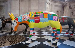 © Licensed to London News Pictures. 30/08/2013. London, UK. 25 life-size painted donkeys created by Egyptian artists are seen in St Paul's Cathedral in London today (30/08/2013).  The donkeys, created to reflect the common identity of Egyptians, regardless of religion, since the 2011 revolution, are on show to visitors to the cathedral. Photo credit: Matt Cetti-Roberts/LNP