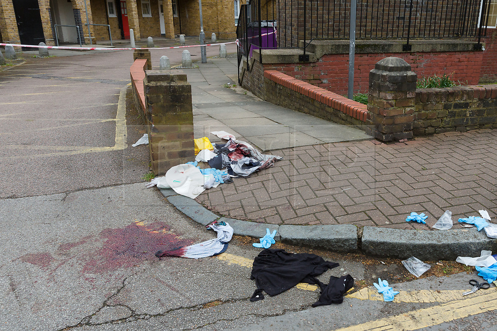 © Licensed to London News Pictures. 29/04/2017. London, UK. Blood stained items of clothing on the street at the crime scene cordon in Green Bank, Wapping, east London. At approximately 23.15 hours on Saturday 28th April Tower Hamlets police were called to an incident at Chancellor House, Green Bank, Wapping, E1W. A male in his mid twenties was discovered with knife wounds and was taken to the Royal London Hospital by London Ambulance Service. Photo credit: Vickie Flores/LNP