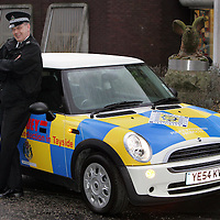 Divisional Crime Prevention officer PC Donald Campbell with his new Mini Police car outside the Tayside Police Western Division HQ in Perth.<br />