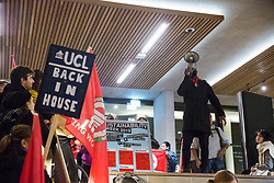 London, UK. 29 October, 2019. A security guard belonging to the Independent Workers of Great Britain (IWGB) trade union addresses students and fellow UCL security officers, cleaners and porters outsourced via Axis and Sodexo at a protest inside the university to call for decent terms and conditions and an end to outsourcing, discrimination and 'precarity and mismanagement'. The terms and conditions of outsourced workers at UCL are considerably worse than for comparable UCL employees, with no occupational sick pay and reduced annual leave entitlement and pensions.