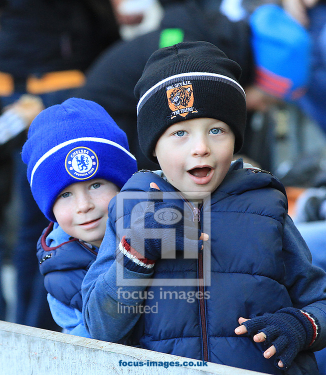 Picture by Richard Gould/Focus Images Ltd +44 7855 403186<br /> 11/01/2014<br /> 2 young fans sporting there club hats during the Barclays Premier League match at the KC Stadium, Kingston upon Hull.