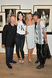 Left to right, KEVIN CARRIGAN Global Creative Director of ck Calvin Klein, DAISY LOWE, ABBEY CLANCY and DAMON BAKER at the Calvin Klein Jeans X mytheresa.com launch the Re-Issue Project at 37 Rathbone Street, London on 17th July 2014.