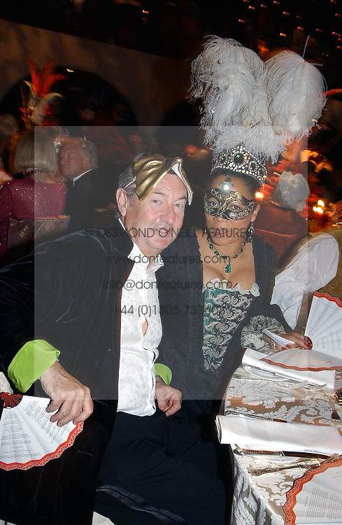 NICK MASON and MRS GAVIN BURKE adopted daughter of the Duke of Richmond at the 2004 Goodwood Revival ball this year theme was a Venetian Masked Ball, held at Goodwood Motor Racing circuit, West Sussex on 4t September 2004.