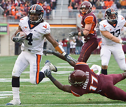 Virginia cornerback Vic Hall (4) sheds a tackle from Virginia Tech safety Kam Chancellor (17) for his second rushing touchdown of the game.  The Virginia Tech Hokies defeated the Virginia Cavaliers 17-14 in NCAA football at Lane Stadium on the campus of Virginia Tech in Blacksburg, VA on November 29, 2008.