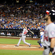 NEW YORK, NEW YORK - July 08: Daniel Murphy #20 of the Washington Nationals batting with Bryce Harper #34 of the Washington Nationals watching while waiting on deck during the Washington Nationals Vs New York Mets regular season MLB game at Citi Field on July 08, 2016 in New York City. (Photo by Tim Clayton/Corbis via Getty Images)