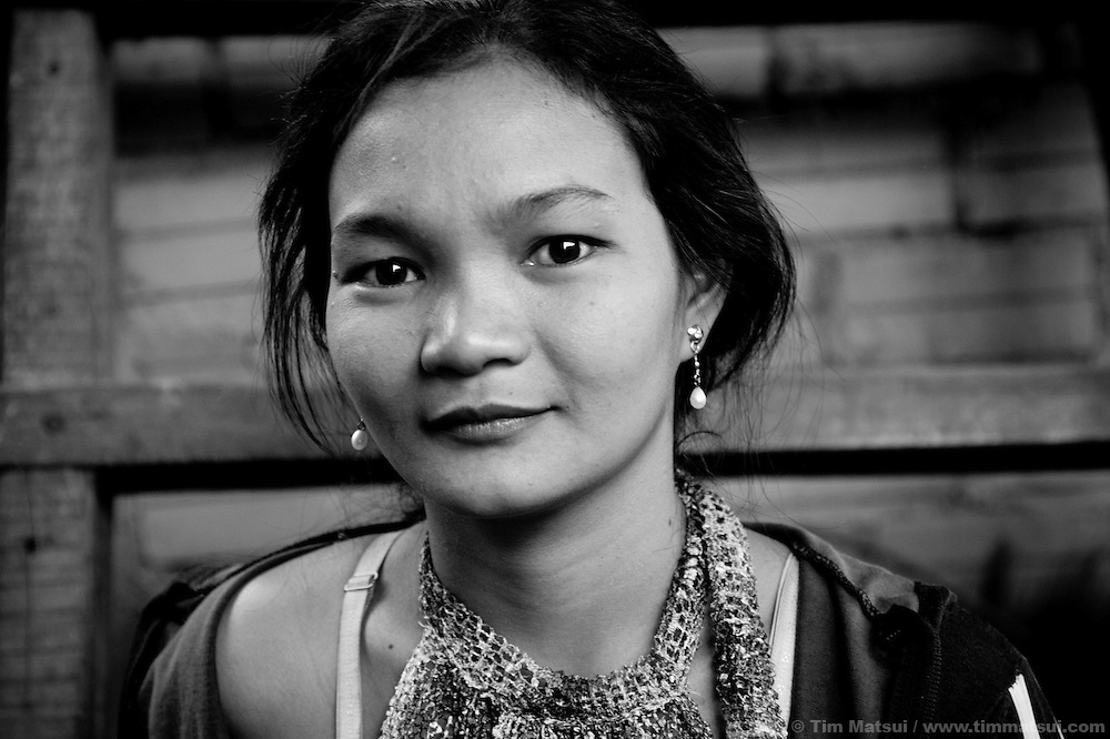 "Srey B, a prostitute living in a slum where ""Acting for Women in Distressing Situations"" (AFESIP) conducts outreach and provides services, in Phnom Penh, Cambodia. The slum's permanent structure, a decaying four story building known simply as 'The Building', was built in the 1960's as transitional housing and now hosts a shantytown where many of the city's poor live, including many prostitutes, and is believed to have the highest rate of HIV infection in the city. AFESIP hands out free condoms, instructs prostitutes on HIV prevention, and conducts outreach in case the prostitutes need medical services, choose to leave their profession, or can report on cases of sex trafficking. AFESIP offers housing, education, training, and counseling for women who are victims of sex trafficking, worked as prostitutes, or are escaping domestic violence. Founded by Somaly Mam, who herself was once a prostitute and victim of trafficking and domestic abuse, AFESIP has three facilities in Cambodia and works with other NGO's to provide long term care for the women."