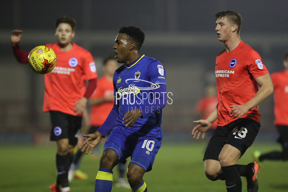 AFC Wimbledon striker Dominic Poleon (10) is shadowed by Brighton & Hove Albion defender Ben Hall (48) during the EFL Trophy match between AFC Wimbledon and U23 Brighton and Hove Albion at the Cherry Red Records Stadium, Kingston, England on 6 December 2016. Photo by Stuart Butcher.