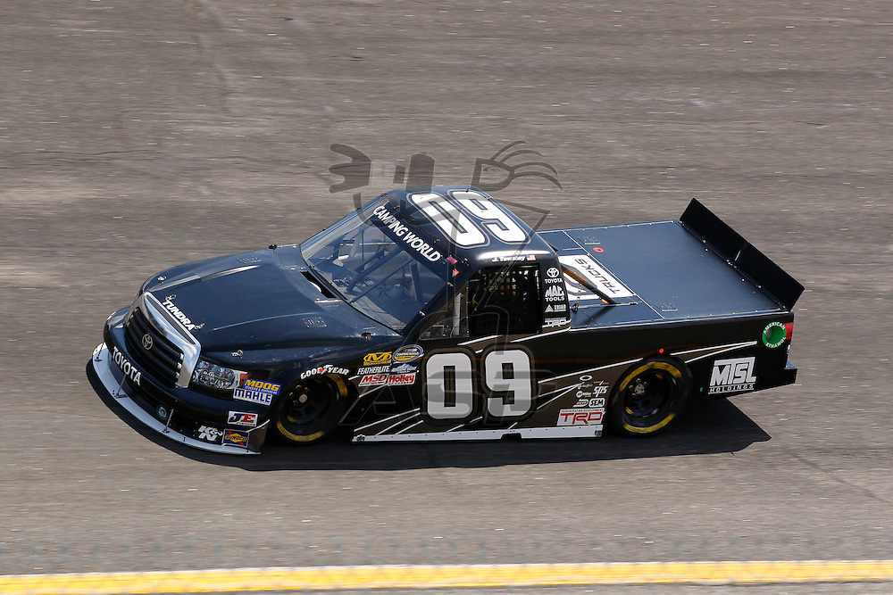 ROCKINGHAM, NC - APR 13, 2012:  John Wes Townley, Jr. (09) brings his truck through the turns during a practice session for the Inaugural Good Sam Roadside Assistance 200 at the Rockingham Speedway in Rockingham, NC.