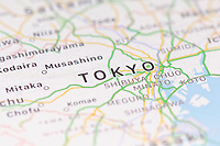 Closeup of Tokyo city map on the screen of a GPS device, Apple iPhone maps app