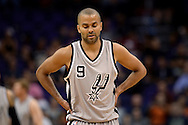 Oct 16, 2014; Phoenix, AZ, USA; San Antonio Spurs guard Tony Parker (9) reacts on the court against the Phoenix Suns in the first half at US Airways Center. Mandatory Credit: Jennifer Stewart-USA TODAY Sports