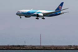 China Southern Boeing 787-8 Dreamliner (B-2735) lands at San Francisco International Airport (SFO), Millbrae, California, United States of America