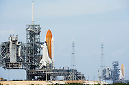 CAPE CANAVERAL, FL - APRIL 17:  Space Shuttles Atlantis (L) and Endeavour sit on launch pads 39-a and 39-b at Kennedy Space Center, in Cape Canaveral, Florida, April 17, 2009. Endeavour arrived at pad b today and Atlantis had its rotating service structure open  preparation for loading its payload. (Photo by Matt Stroshane/Getty Images)