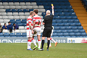 Doncaster Rovers Defender, Mitchell Lund shown a yellow card, booked during the Sky Bet League 1 match between Bury and Doncaster Rovers at the JD Stadium, Bury, England on 9 April 2016. Photo by Mark Pollitt.