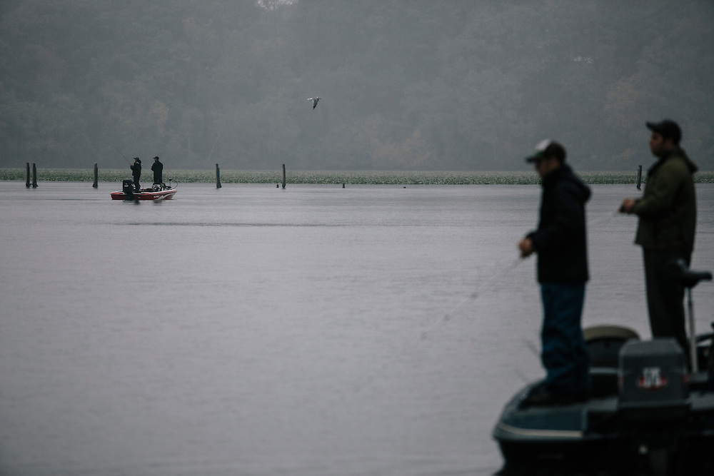 Seth Winslow, right, and Travis Riley, left, of Christopher Newport University, fish for bass during the FLW College Fishing Northern Conference Invitational in Marbury, MD on Oct. 11, 2014. Only the top 15 of 43 teams moved on to Sunday.