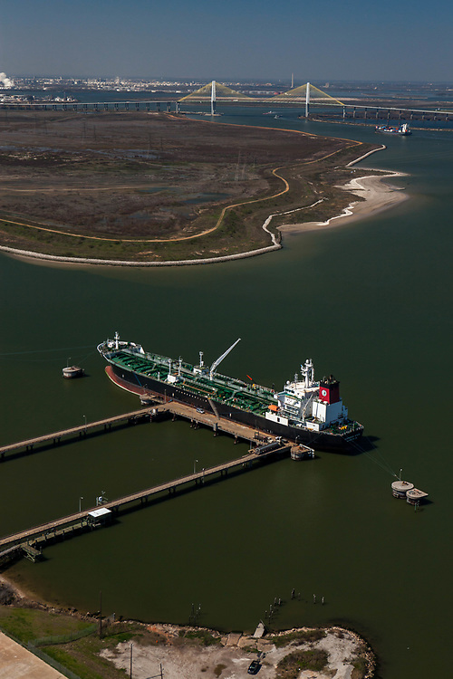 Tanker docked at the Lash Dock in Morgans Point. Port of Houston with the ship channel and Hartman Bridge on the horizon.