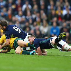 LONDON, ENGLAND - OCTOBER 18: Greig Laidlaw (captain) of Scotland tackling Adam Ashley-Cooper of Australia during the Rugby World Cup Quarter Final match between Australia v Scotland at Twickenham Stadium on October 18, 2015 in London, England. (Photo by Steve Haag)