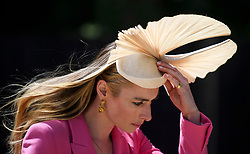 © Licensed to London News Pictures. 21/06/2018. London, UK. FIONA MCDONALD JOHNSON arrives for Day at Royal Ascot at Ascot racecourse in Berkshire, on June 21, 2018. The 5 day showcase event, which is one of the highlights of the racing calendar, has been held at the famous Berkshire course since 1711 and tradition is a hallmark of the meeting. Top hats and tails remain compulsory in parts of the course. Photo credit: Ben Cawthra/LNP