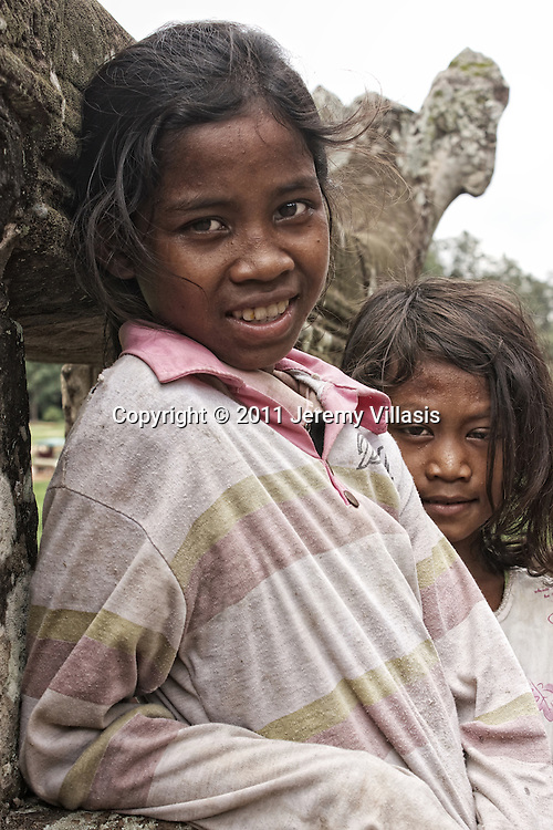 Young locals at the Leper King Terrace in Angkor Thom's Royal Square.